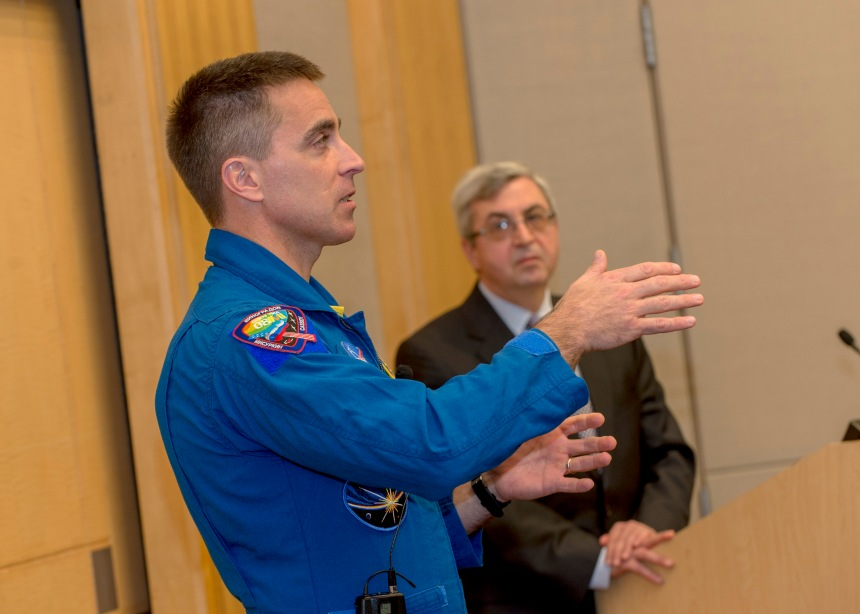NASA's Commander Christopher Cassidy presents surgery grand rounds. Background: BWH cardiac surgeon Sary Aranki, MD.