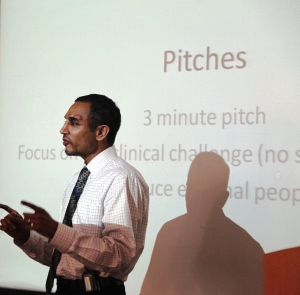Ashwin Dharmadhikari, MD, MPH, Division of Global Health Equity, pitches challenges staff face in the intensive care units (ICU) when transferring patients in and out of the ICU.