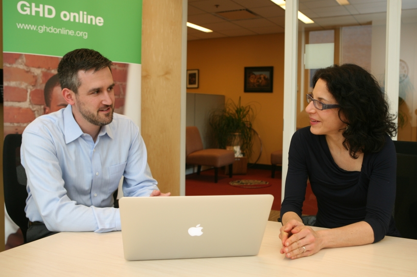 Aaron Beals, information systems project manager, BWH Division of Global Health Equity, talks with Rebecca Weintraub, MD, faculty director of the Global Health Delivery Project and associate physician in the BWH Division of Global Health Equity, about GHDonline.