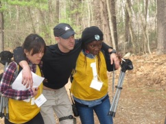 Students Saki Onda (at left) and Olufunke Fayemi (at right) help transport volunteer Scott Irvine, who played a refugee with war injuries, during a simulated refugee crisis. Photo courtesy of Adina Davies.