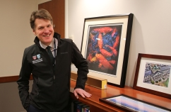 James Rathmell, MD, stands by two photographs he has taken.