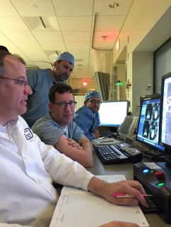 The MRgFUS treatment team use images to visualize the prostate gland and identify its cancerous portions. From left: Nathan McDannold, Adam Kibel, Kemal Tuncali (behind) and Evan Boland.