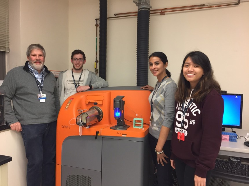 From left: Jim Lederer, Josh Keegan, Anu Seshadri, MD, and Jenni Nguyen with one of the CyTOF instruments, used to simultaneously look at multiple markers on individual cells.