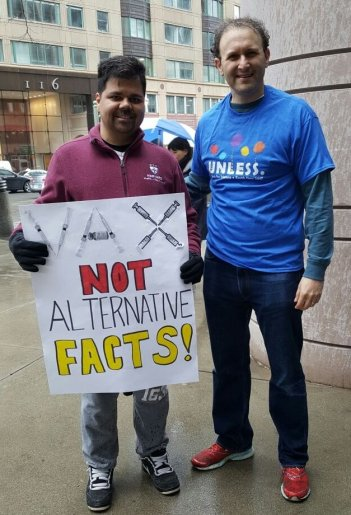 Michael Sinha marches with his mentor, Aaron Kesselheim