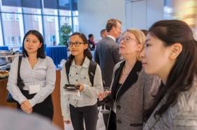 Speaker Margaret McCarthy (center) joins Brigham researchers at post-symposium reception.